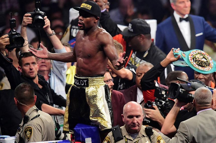Floyd Mayweather Jr. celebrates after defeating Manny Pacquiao (not pictured) via unanimous decision during their world welterweight championship bout  at the MGM Grand Garden Arena in Las Vegas, Nevada. -- PHOTO: REUTERS