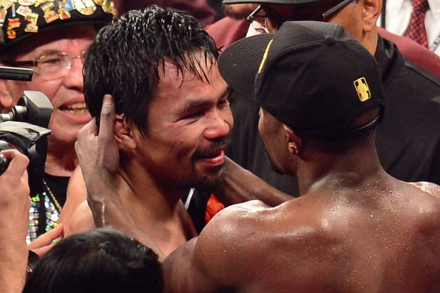 Floyd Mayweather Jr. and Manny Pacquiao hug after their welterweight unification bout on May 2, 2015 at the MGM Grand Garden Arena in Las Vegas, Nevada. -- PHOTO: AFP