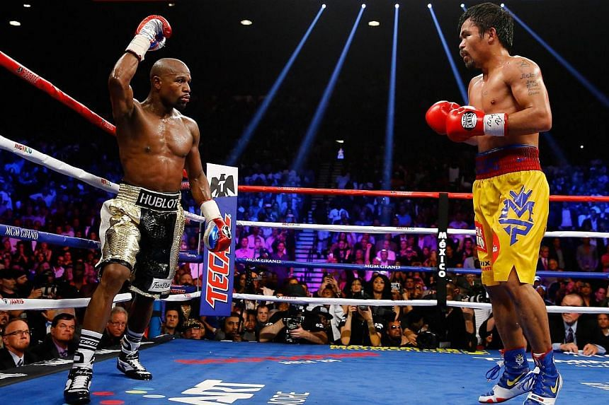 Floyd Mayweather Jr. reacts in the twelfth round during the welterweight unification championship bout on May 2, 2015 at the MGM Grand Garden Arena in Las Vegas, Nevada. -- PHOTO: AFP