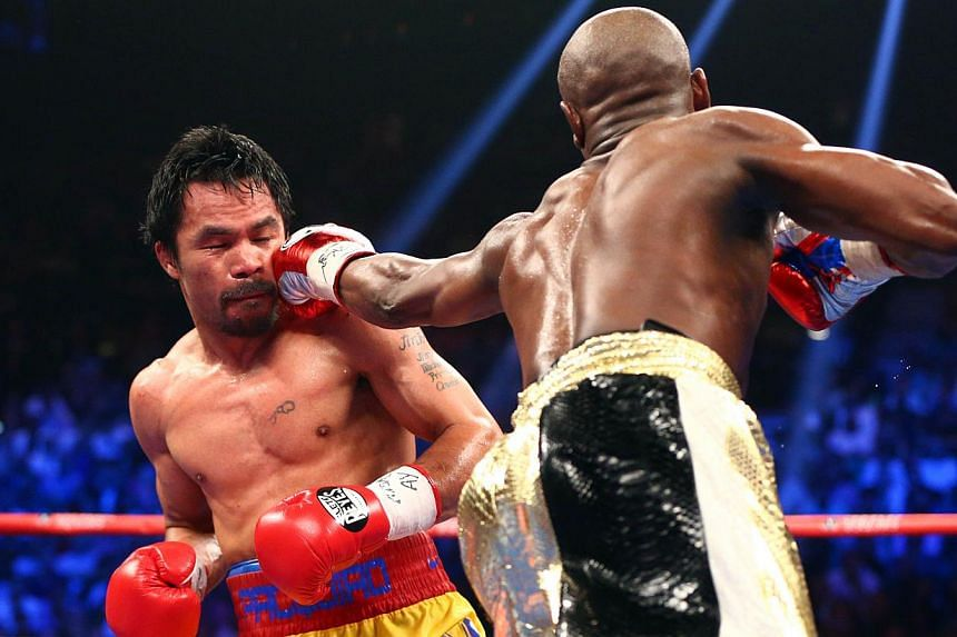 Floyd Mayweather Jr. and Manny Pacquiao box during their world welterweight championship bout at the MGM Grand Garden Arena in Las Vegas, Nevada. -- PHOTO: REUTERS
