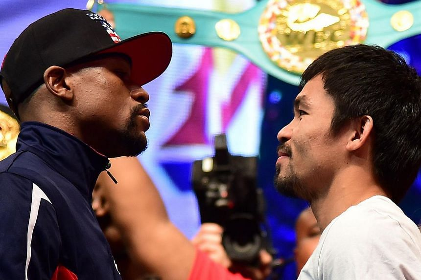 """Floyd Mayweather and Manny Pacquiao face off following their weigh-in on May 1, 2015, in Las Vegas, Nevada one day before their """"Fight of the Century"""" on May 2 at the MGM Grand Garden Arena. -- PHOTO: AFP"""