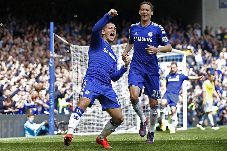 Eden Hazard celebrates after scoring the first goal for Chelsea. The English football club bagged a fourth English Premier League title with three more games to go on Sunday. -- PHOTO: REUTERS