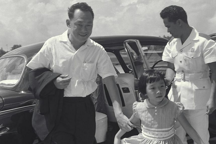 Singapore's founding Prime Minister Lee Kuan Yew seen here with his daughter Wei Ling in 1962. Mr Lee passed away on March 23, 2015. -- PHOTO: ST FILE