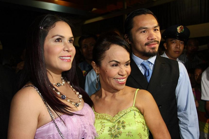 (From right) World welterweight boxing champion Manny Pacquiao is seen with his mother Dionisia Pacquiao and wife Jinkee Pacquiao at the KCC Mall on May 15, 2010 in General Santos, Philippines. -- PHOTO: GETTY IMAGES