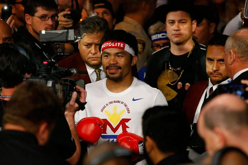 Manny Pacquiao walks to the ring with Jimmy Kimmel before his welterweight unification championship bout against Floyd Mayweather Jr. on May 2, 2015 at MGM Grand Garden Arena in Las Vegas, Nevada.-- PHOTO: AFP