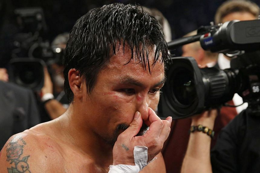 Filipino ring icon Manny Pacquiao revealed he was battling a right shoulder injury on Saturday, May 2, 2015, in his unanimous decision defeat by American Floyd Mayweather in their welterweight bout. -- PHOTO: REUTERS