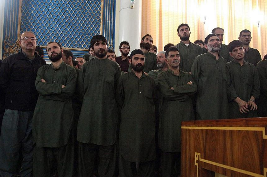 Unidentified suspects linked to the mob killing of a woman in the Afghan capital of Kabul attend their primary court trial in Kabul, Afghanistan on May 2, 2015. -- PHOTO: EPA