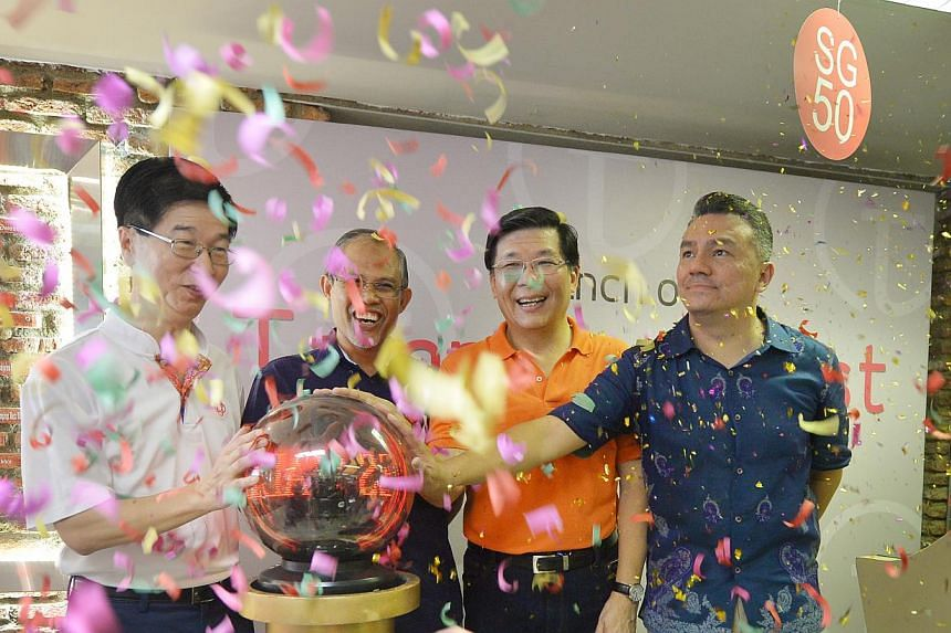 (From left) Mr Ang Hak Seng, Chief Executive Director, People's Association, Minister Masagos Zulkifli, Mr Ng Cheng Huat, and Mr Suhaimi Rafdi at the open house for the new Tampines West CC on May 3, 2015. -- ST PHOTO: ALPHONSUS CHERN