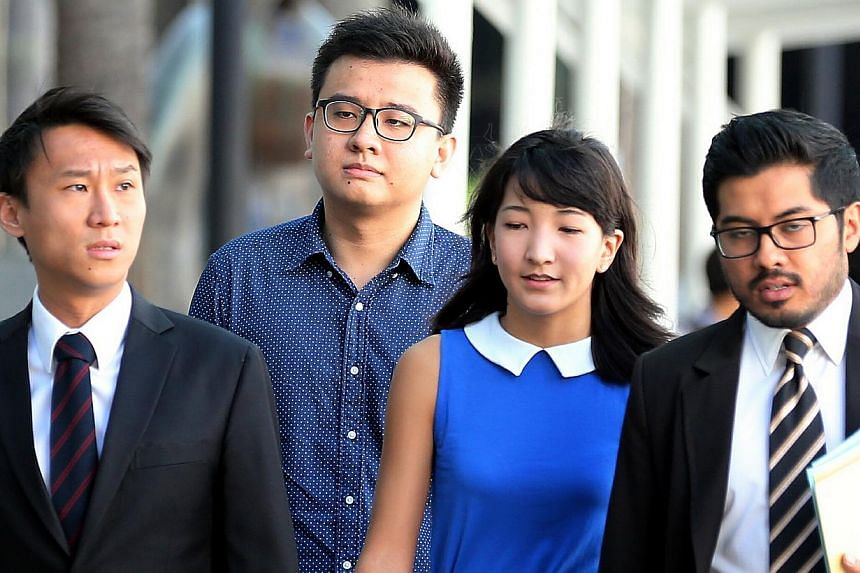 Yang Kaiheng (second left) and Ai Takagi (second right), the couple behind socio-political website The Real Singapore (TRS) have had their licence to operate the website suspended by the Media Development Authority (MDA). -- ST PHOTO:
