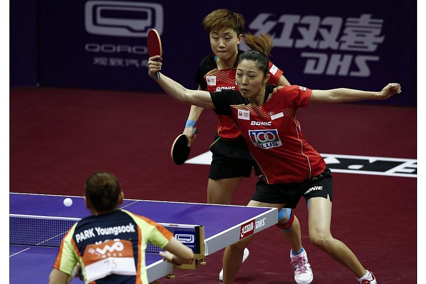 Feng Tianwei (left) and Yu Mengyu (right) of Singapore in action against Park Young Sook and Yang Ha Eun of South Korea in the quarterfinals of the Women's Doubles of the 2015 World Table Tennis Championships at the Suzhou International Expo Centre i