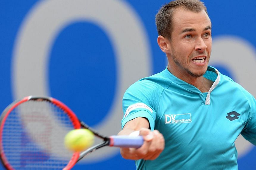 Andy Murray defended his astonishing outburst at Lukas Rosol (above) on Saturday when he told the controversial Czech he was the tour's most hated man. -- PHOTO: AFP