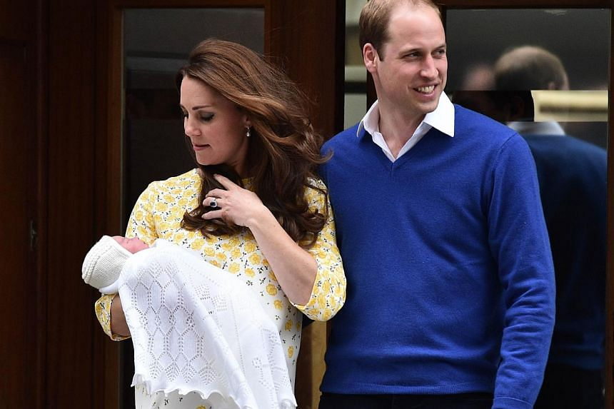 Britain's Prince William, Duke of Cambridge, and his wife Catherine, Duchess of Cambridge show their newly-born daughter, their second child, to the media outside the Lindo Wing at St Mary's Hospital in central London, on May 2, 2015. -- PHOTO: AFP