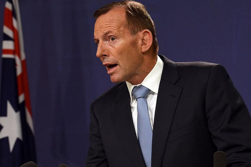 Australian Prime Minister Tony Abbott on Monday said Australia and Europe were in talks on how to stop asylum-seeker boats after the success of his government's controversial polices on the issue. -- PHOTO: AFP