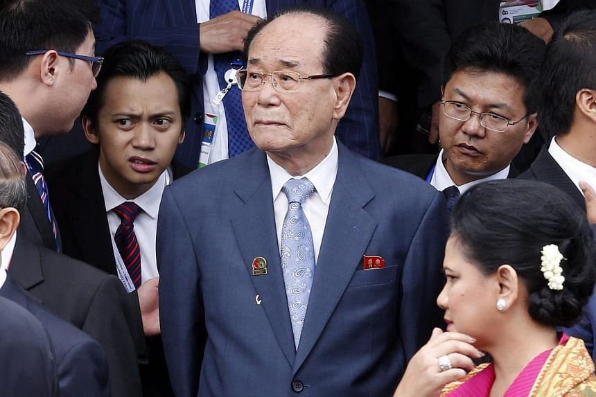 North Korea's Chairman of the Supreme People's Assembly, Kim Yong Nam (centre) walks out of Gedung Merdeka shortly after the reenactment of the historic walk from 1955 along Asia Africa Street marking the 60th Asian African Conference Commemoration i