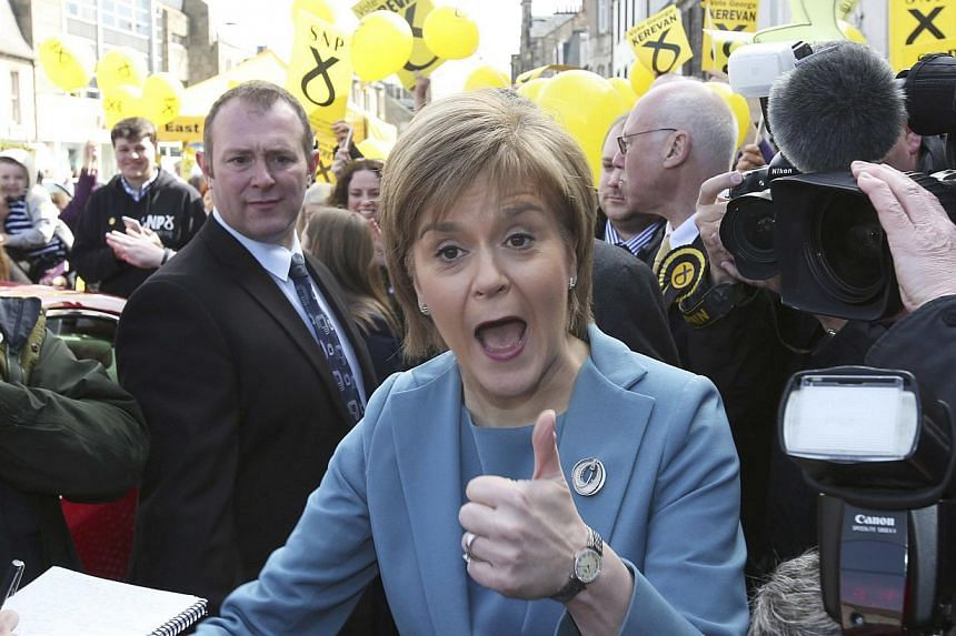 Nicola Sturgeon, the leader of the Scottish National Party (SNP), gives a thumbs up while campaigning in Musselburgh, Scotland, Britain on May 1, 2015. -- PHOTO: REUTERS