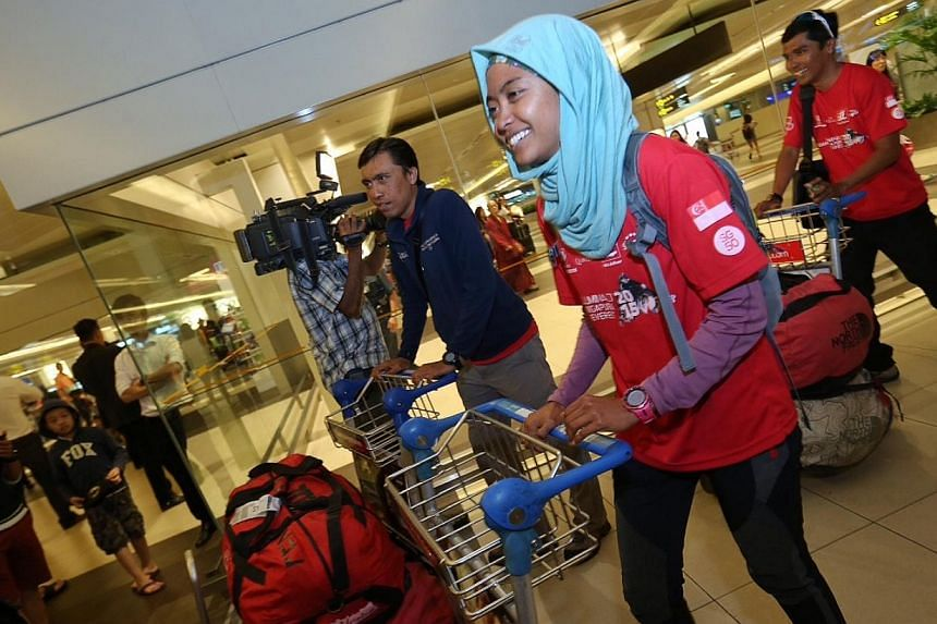 The remaining three team members, Ismail Latiff, Nur Yusrina Yaakob and Zulkifli Latiff have safely descended from Everest Base Camp and arrived in Singapore at Changi Airport Terminal 2 on May 4, 2015. They landed in Singapore at 8:10pm. -- ST PHOTO