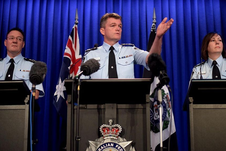 (Left to right) Australian Federal Police (AFP) Deputy Commissioner Michael Phelan, AFP Commissioner Andrew Colvin and Deputy Commissioner Leanne Close speak to the media during a press conference in Canberra, Australia, on May 4, 2015. -- PHOTO: EPA