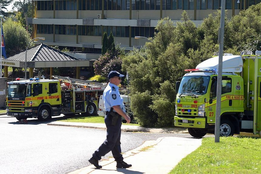Two Hazardous Materials (HAZMAT) teams of the Canberra fire brigade respond to a suspicious package at the Indonesian Embassy in Canberra, Australia, on May 4, 2015. -- PHOTO: EPA