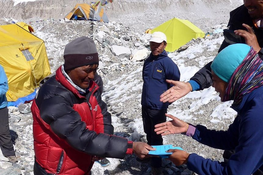 The team members giving envelopes containing cash to their guides. Each envelope also had a personal thank you note addressed to each guide.-- PHOTO: ALUMINAID TEAM SINGAPURA EVEREST