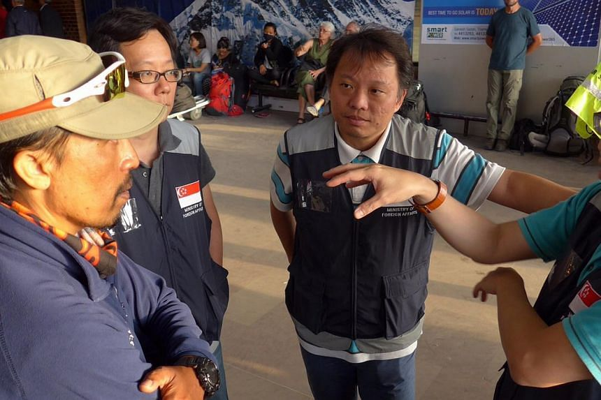 Singapore's Everest team speaking to staff members from the Ministry of Foreign Affairs, who were on the ground to assist, at Kathmandu Airport.-- PHOTO: ALUMINAID TEAM SINGAPURA EVEREST