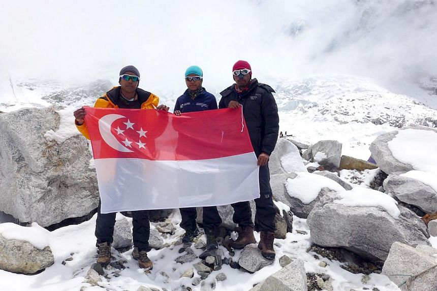 The three members from Aluminaid Team Singapura Everest 2015 are (from left) Mr Ismail Latiff, Ms Nur Yusrina Ya'akob and Mr Zulkifli Latiff. This picture taken on April 26, 2015 shows them safe at the mountain's base camp and holding the Singapore