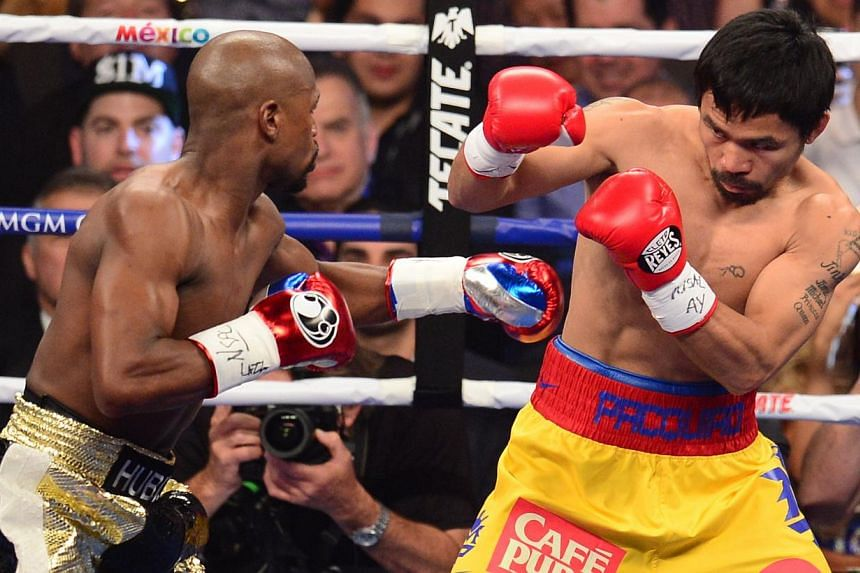 Boxer and politician Manny Pacquiao, 36, is expected to donate half of his earnings from Saturday's boxing match with Floyd Mayweather Jr to charity. --PHOTO: AFP