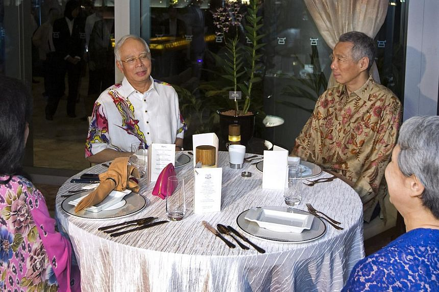 Prime Minister Lee Hsien Loong and his wife Ho Ching hosted Malaysian Prime Minister Najib Razak and his wife Rosmah Mansor to a private dinner on Monday night at Sentosa Cove. -- PHOTO: MINISTRY OF COMMUNICATION AND INFORMATION