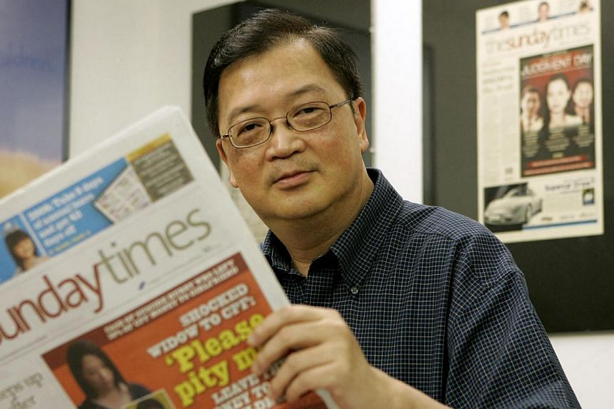 ST's former deputy editor Felix Soh showing a copy of The Sunday Times. -- ST PHOTO: ALAN LIM