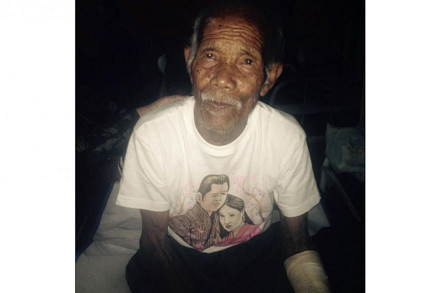 Funchu Tamang, 101, sits on a bed in a hospital in Nuwakot district on May 3, 2015 around 80 kilometres north-west of Kathmandu where he was taken after being rescued from his collapsed home a day earlier. -- PHOTO: AFP