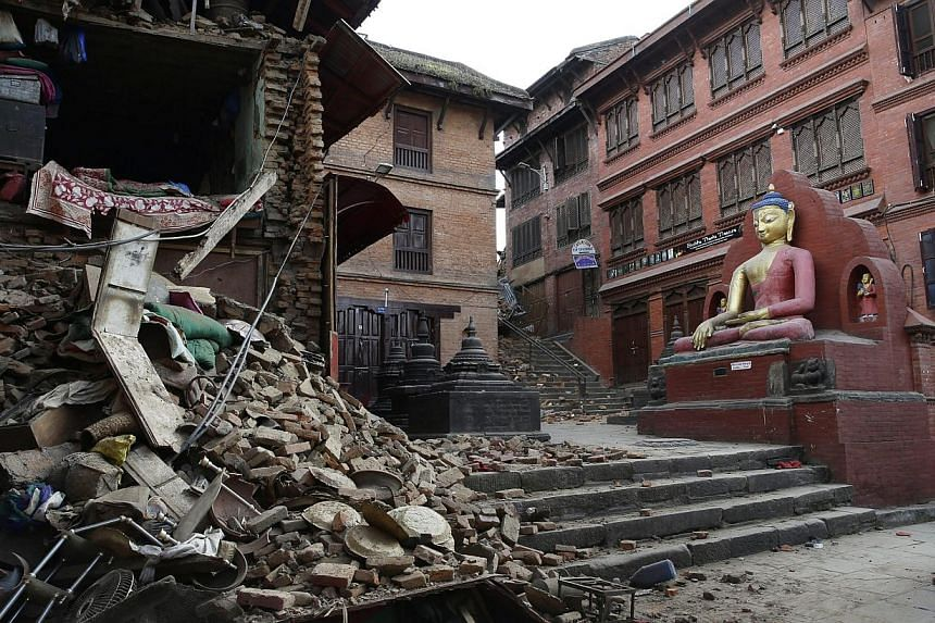 The damage at Nepalese heritage site Syambhunaath Stupa, also known as monkey temple, after a powerful earthquake struck Nepal, in Kathmandu, Nepal, on April 26, 2015. -- PHOTO: EPA