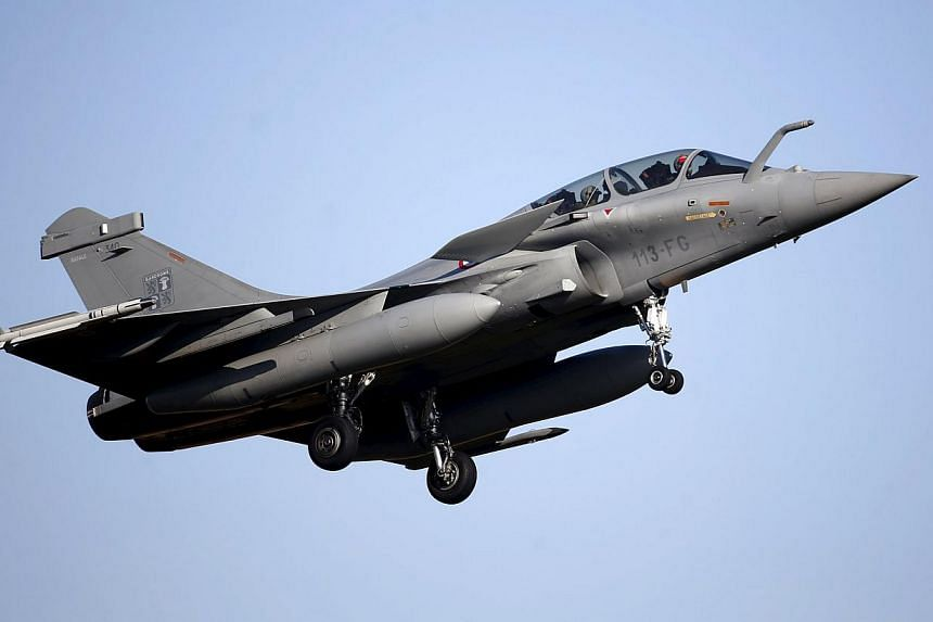 A Rafale fighter jet prepares to land at the air base in Saint-Dizier, in this file picture taken on Feb 13, 2015. India is close to finalising a deal for dozens of Rafale fighter jets during its prime minister's visit to France. -- PHOTO: AFP