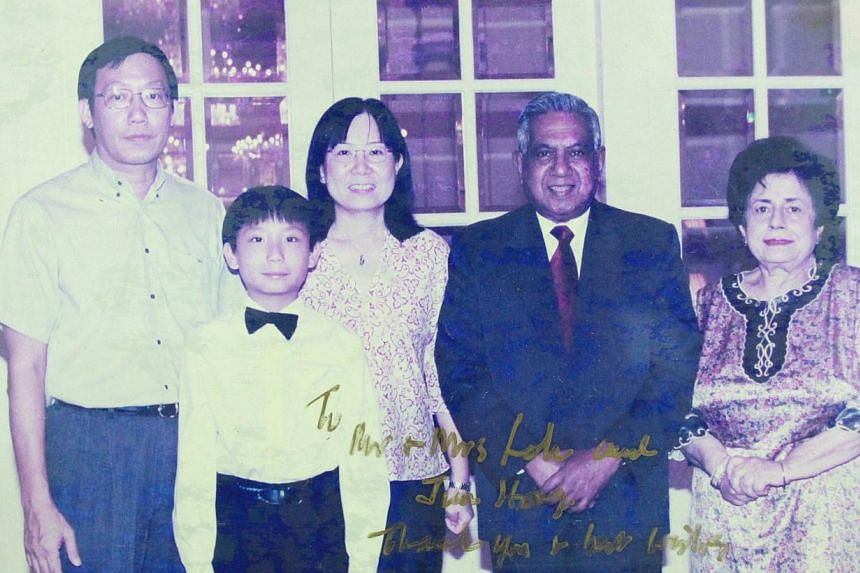 Loh Jun Hong with his parents, Mr Loh Lean Chooi and Madam Lim Ben Tjoe, and former President S R Nathan and his wife in 2001 at an Istana dinner for Heads of Missions where he performed. -- PHOTO: COURTESY OF LOH JUN HONG