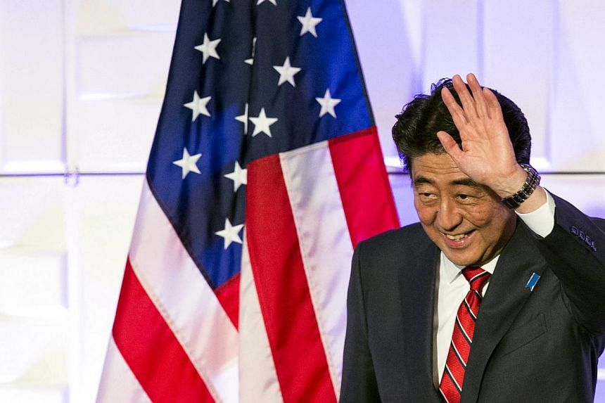 Japan's Prime Minister Shinzo Abe waves after speaking at a luncheon at the Japan-US Economy Forum in Los Angeles, California, on May 1, 2015. South Korean President Park Geun Hye said Mr Abe missed an opportunity to improve ties between their countr