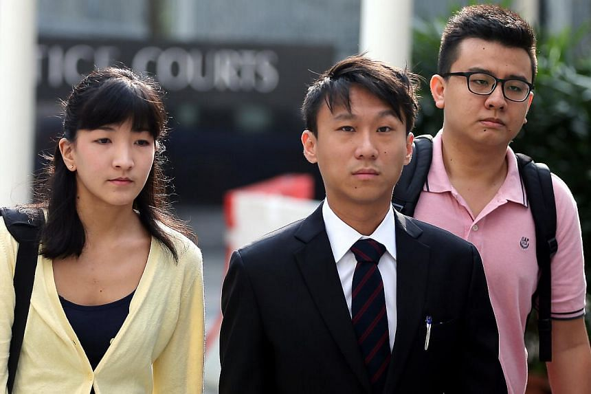 Ai Takagi (left) and Yang Kaiheng (right), the two editors behind socio-political website The Real Singapore, arriving at the court with their lawyer Choo Zheng Xi (centre) on May 4, 2015. Mr Yang, 26, has applied to return to Australia as his father