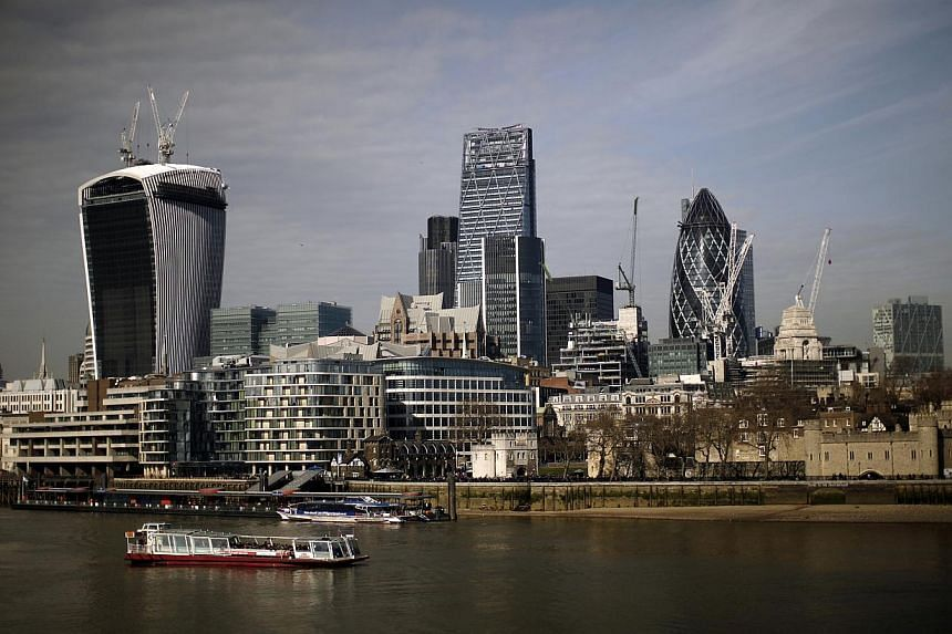 "Skyscrapers including 20 Fenchurch Street, also known as the ""Walkie-Talkie,"" left, stand on the skyline of the City of London in London, U.K., on Wednesday, March 5, 2014. The Consumers Association of Singapore (Case) said on Monday it is ""very conc"
