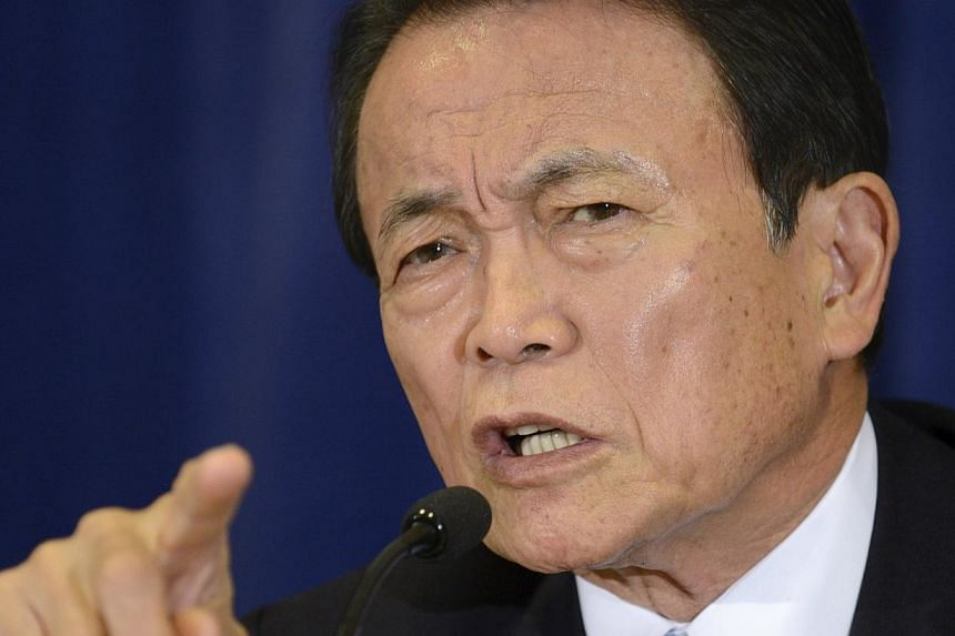 Japan's Finance Minister and Deputy Prime Minister Taro Aso makes remarks during a news conference in Washington last month. -- PHOTO: REUTERS