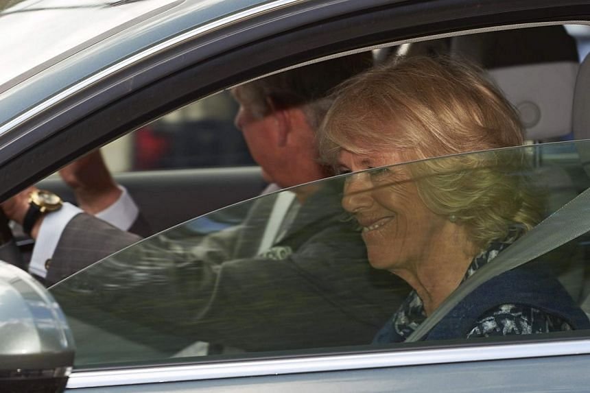 Britain's Prince Charles and wife Camilla, Duchess of Cornwall leave Kensington Palace on Sunday in London after visiting Prince William and wife Kate following the birth of their daughter. -- PHOTO: AFPAFP