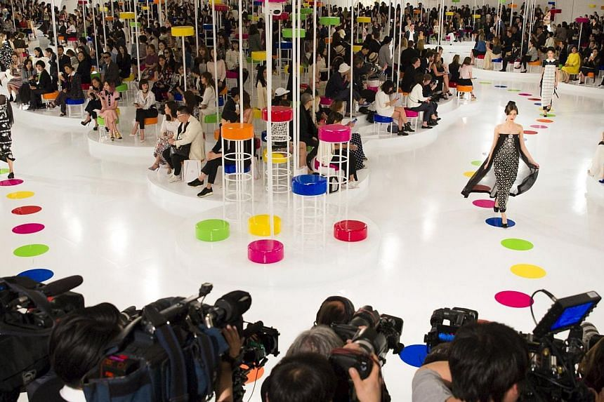 Models present creations of the Chanel Cruise Collection 2015/16 at the Dongdaemun Design Plaza in Seoul on Monday. French fashion house Chanel looked to traditional South Korean dress for its cruise collection, unveiling a colourful inter-seasonal l
