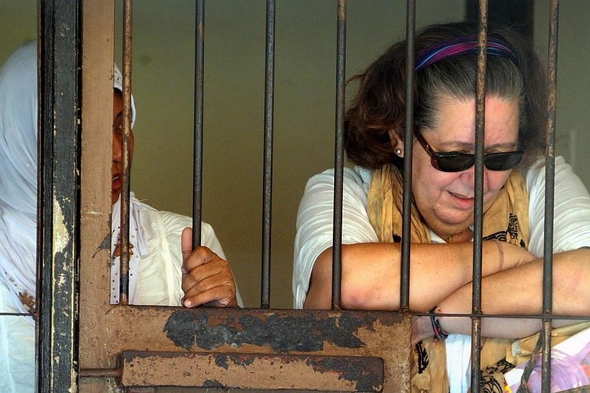 Lindsay Sandiford (right) of Britain reacting inside a holding cell after her trial at a court in Denpasar on the Indonesian resort island of Bali in a file photo taken on Nov 28, 2012. -- PHOTO: AFP