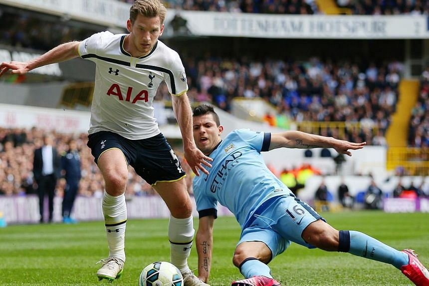 Tottenham's Jan Vertonghen in action with Manchester City's Sergio Aguero on Sunday. -- PHOTO: REUTERS