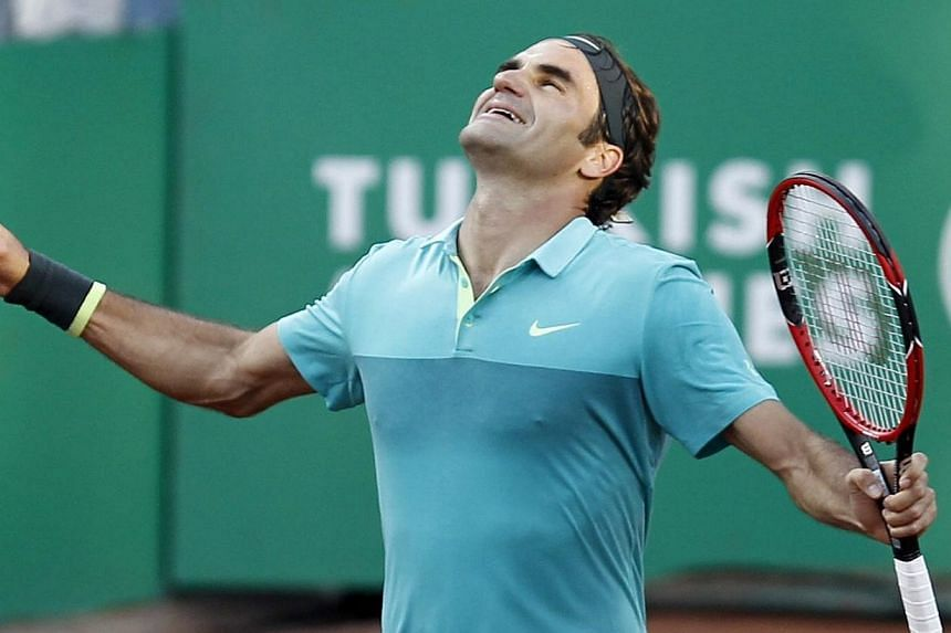 Roger Federer of Switzerland celebrates after winning Pablo Cuevas of Uruguay during the final match at the TEB BNP Paribas Istanbul Open tennis Tournament in Istanbul, Turkey on Sunday.-- PHOTO: EPA