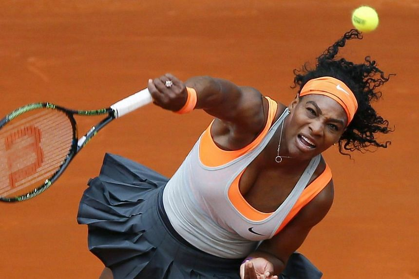 US tennis player Serena Williams returns the ball to her countryman Madison Brengle during the second jouney of the Madrid Mutua Open tennis tournament match in Madrid, Spain on Sunday. -- PHOTO: EPA