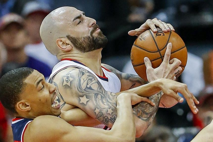 Washington Wizards forward Otto Porter Jr. (left) and Atlanta Hawks forward Pero Antic (right) of Macedonia battle for a rebound during the second half of game one of the NBA Eastern Conference semifinal round series between the Washington Wizards an