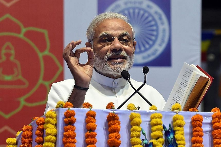 Indian Prime Minister Narendra Modi delivering a speech during International Buddha Poornima Diwas celebrations in New Delhi on May 4, 2015. Mr Modi attracted thousands of Internet users on Monday by opening an account on one of China's most popular
