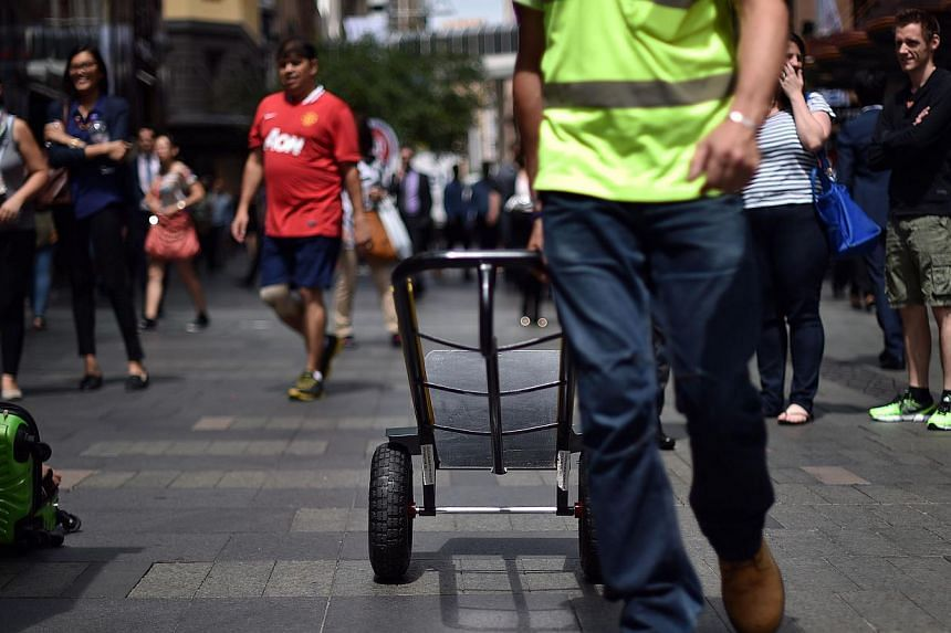 A worker returning after making a delivery in the Sydney Central Business District on March 4, 2015. An Australian state government said on Tuesday it would hold an inquiry into the exploitation of migrant workers after a television investigation rev