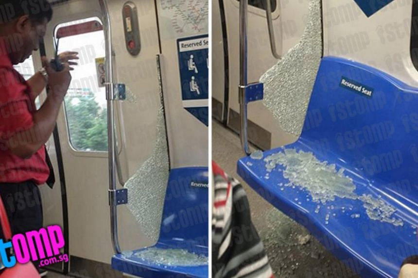 "Train passenger Shah, who captured the incident in photos, told citizen journalism website Stomp that he heard ""a loud noise"" when the glass broke. -- PHOTO: STOMP"