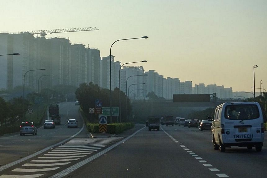 A slightly hazy skyline along the Tampines Expressway (TPE) with Punggol housing estate in the background taken at 7.20am on Tuesday, May 5, 2015. -- ST PHOTO: STEPHANIE YEOW