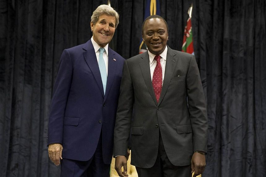 US Secretary of State John Kerry (left) poses for a photograph with Kenyan President Uhuru Kenyatta at the State House, in Nairobi, on May 4, 2015. -- PHOTO: AFP