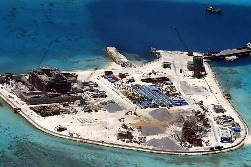 China has accused the Philippines of violating a 13-year-old informal code of conduct in the South China Sea with its building work on disputed islets, firing back again after repeated criticism of China's own construction work. -- PHOTO: EPA