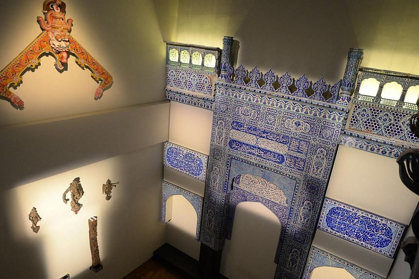 ARTEFACTS ON SHOW: A two-storey glazed ceramic tile mosque facade from Multan, Pakistan, dating back to the 1890s, pictured on April 22, 2015. -- ST PHOTO: MARK CHEONG